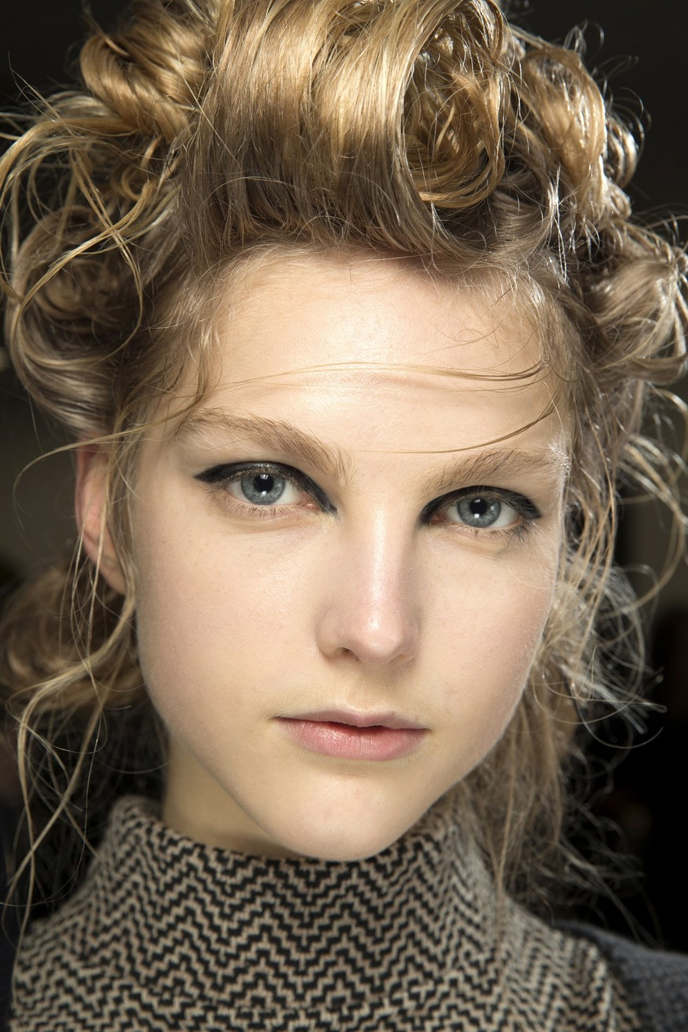 Simone Rocha - James Pecis styled the hair in piled-up up-dos with a wet-look finish.