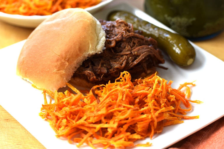 A BBQ Beef Brisket Sandwich with Sweet Potato Strings.  The beef is bathed in Farmer    's Market Barbecue Sauce!