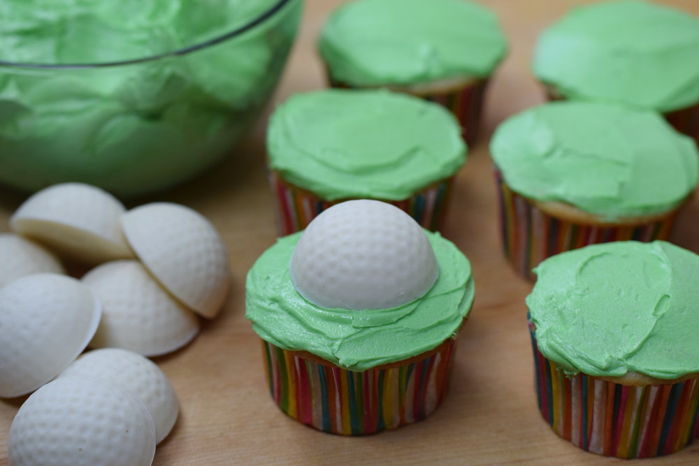 Cupcakes frosted & ready for grass!.JPG