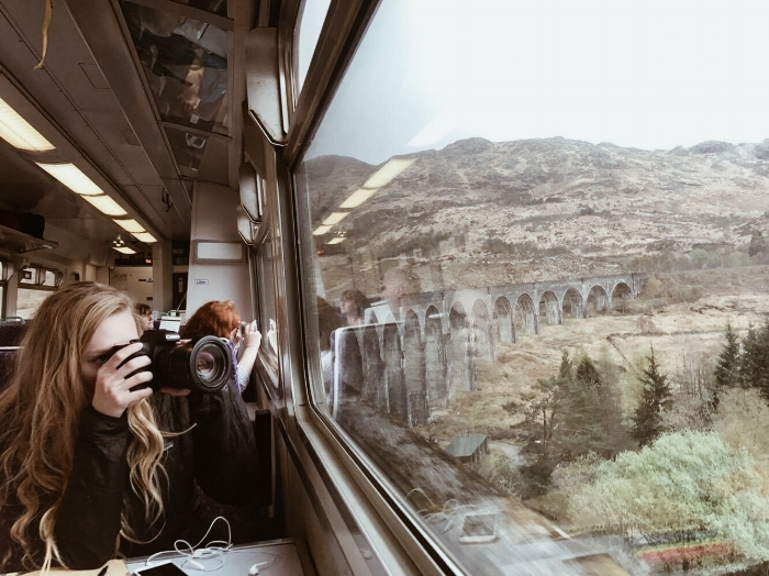 the train ride in scotland across the harry potter bridge.