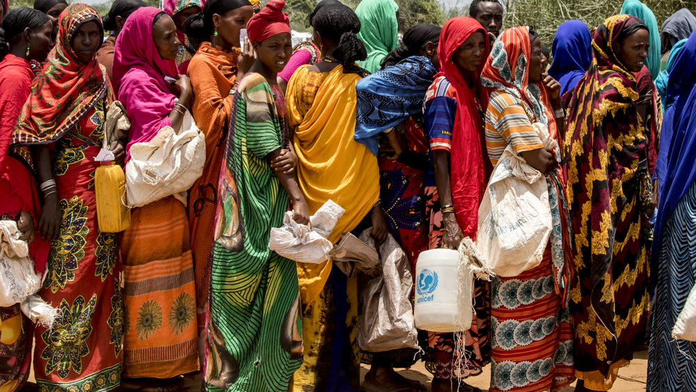 April 1, 2018, Dambala Fachana, Kenya- Refugee women wait in line to receive food and water rations for the next two weeks.