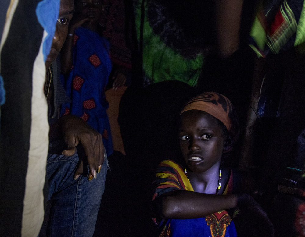 April 1, 2018, Dambala Fachana, Kenya- Two refugees peer inside the shelter at night.