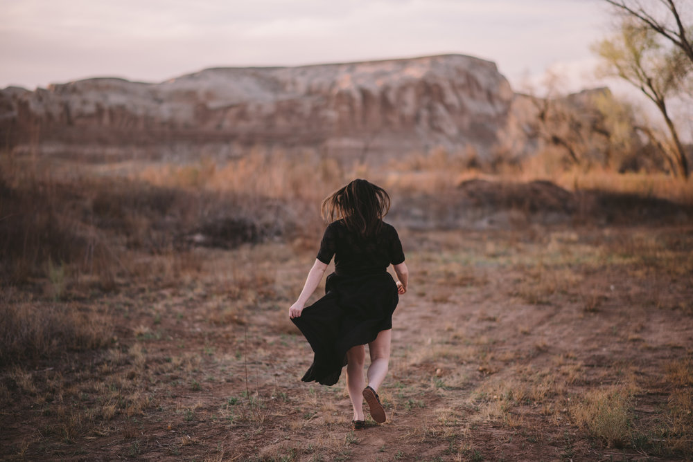 A real life photo of me chasing sunsets + dreams in Moab, Utah.