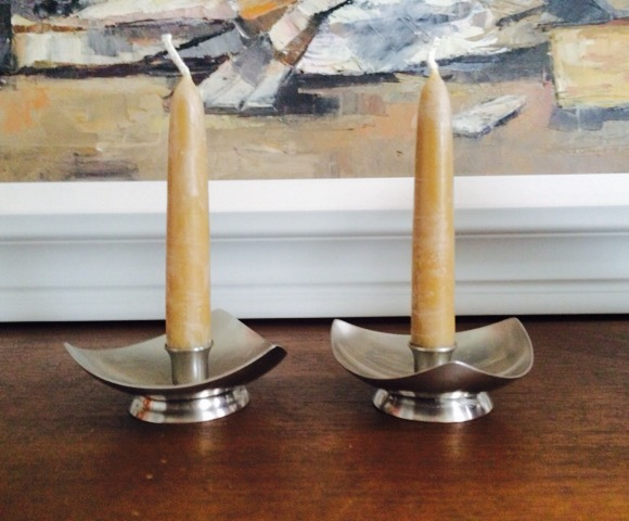 Mid-century stainless steel candle holders working the beeswax candles here!