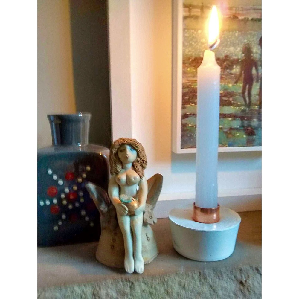 'White edition'candle holder by the wonderful Copper + Solder sitting nicely on the stone shelf, next to the naked lady Eve!