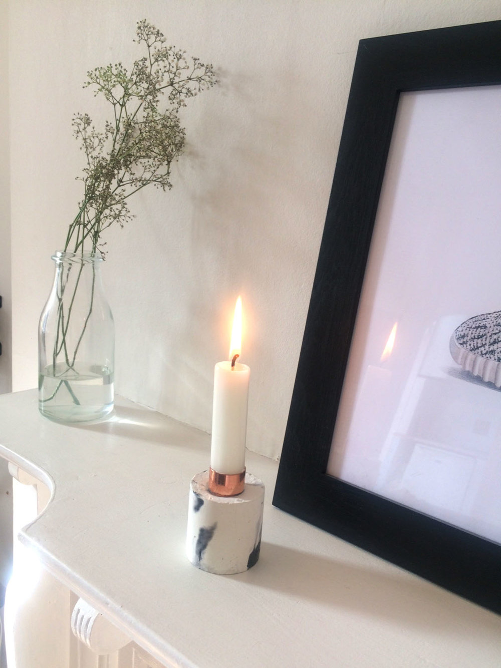 Copper + Solders marbled concrete candle holder looks sublime in its new London home......how lovely!