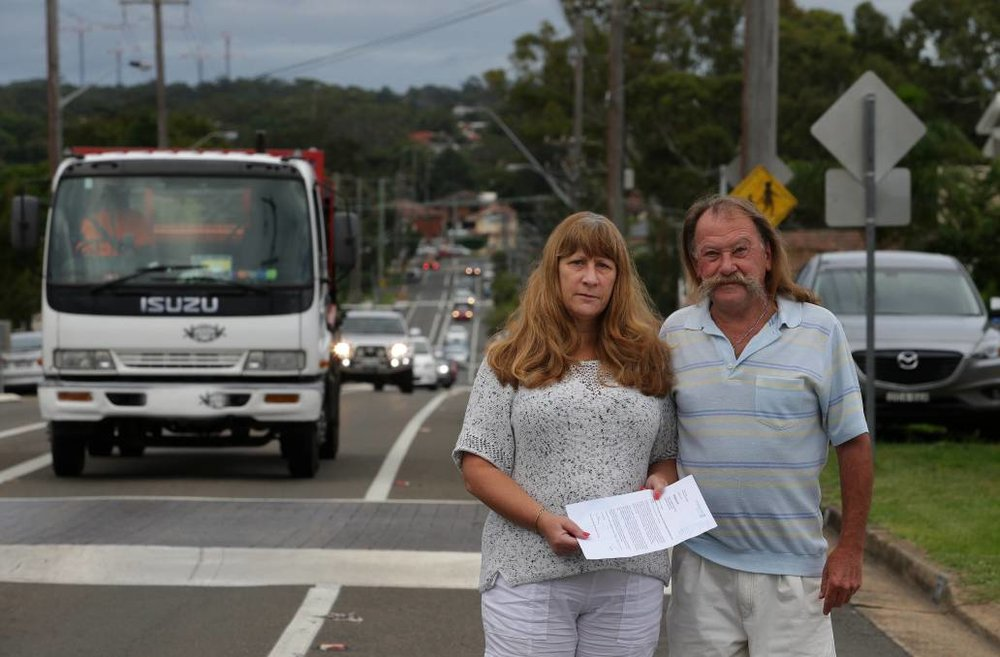 """Blindsided"": Sadie and David Mehan with a letter from the council about the proposed supermarket near their Parraweena Road home. Picture: John Veage"