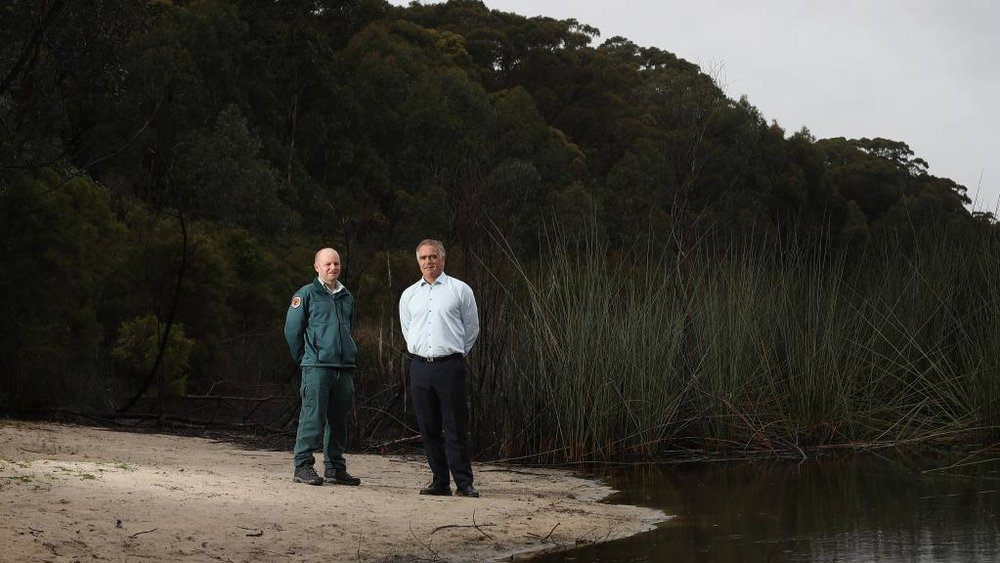Ranger Ben Owers and OEH director of water wetlands and coast lines Tim Pritchard at Thirlmere Lakes. Picture: Carmela Roche