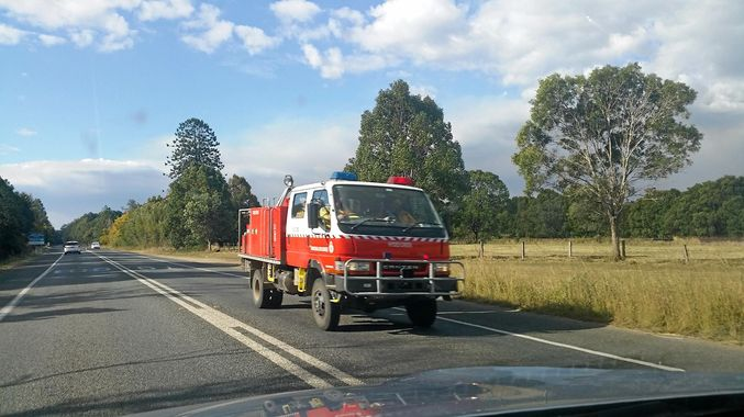 ROAD TRAIL: A Coffs Harbour RFS strike team heads south on the Pacific Motorway to assist with a large grass fire at Clybucca. Picture: Trevor Veale