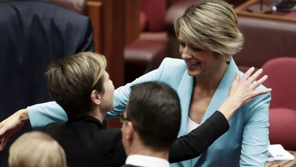 Kristina Keneally is congratulated by Senator Jenny McAllister after delivering her maiden speech in the Senate. Photo: Alex Ellinghausen