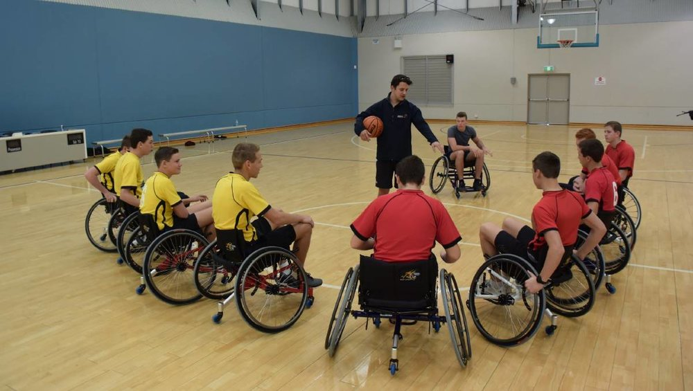 Wheelchair Sports NSW's Joe Shoebridge goes through the rules with the players.