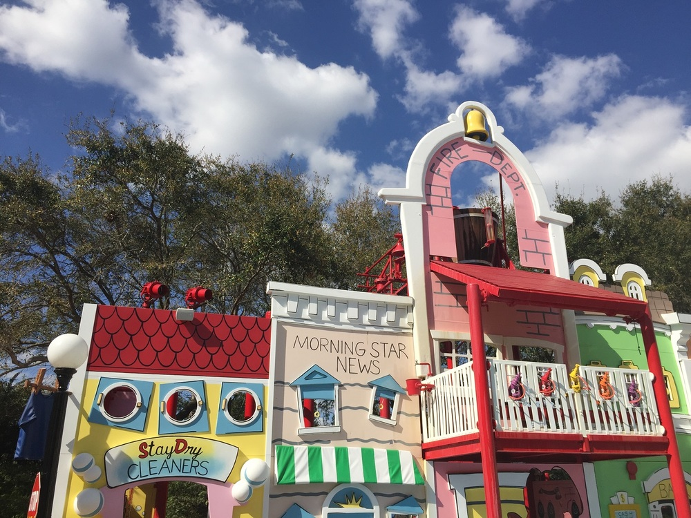 The buildings in Curious George Goes To Town are decorated with water cannons