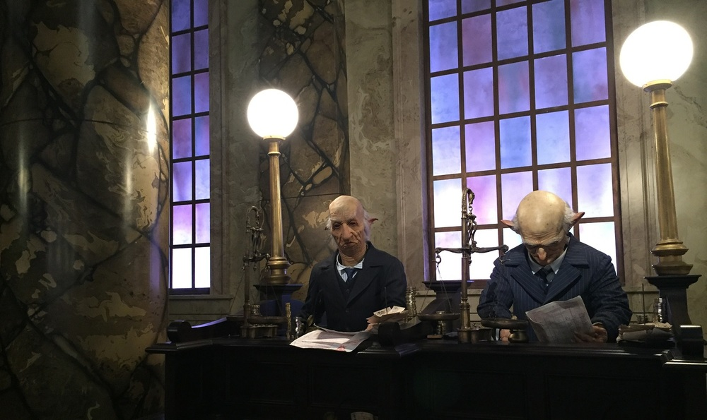Animatronic goblins work in the Gringotts Bank.
