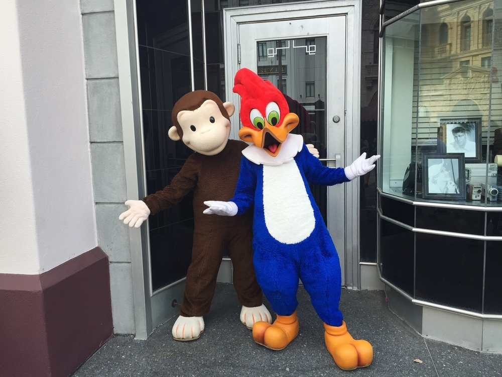 Curious George and Woody Woodpecker posing for pics in Universal Studios Florida.