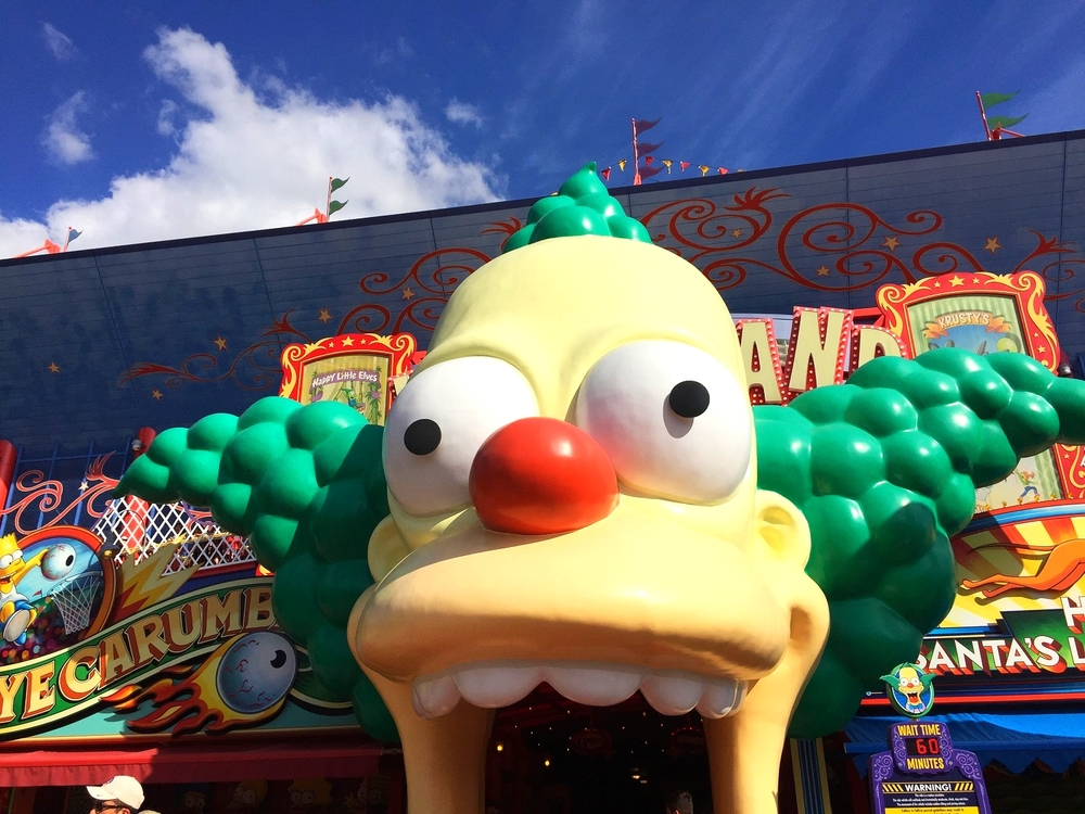 Guests enter The Simpsons Ride by walking into the mouth of a giant Krusty the Clown.