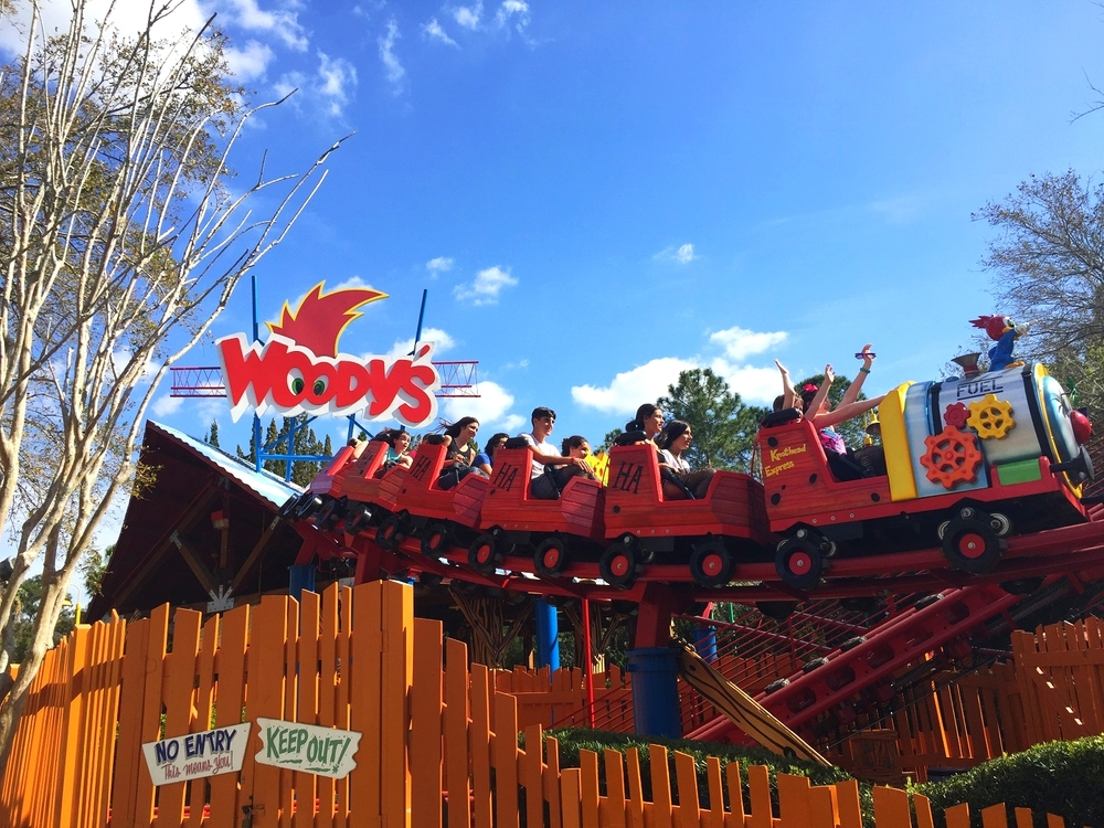 The ride vehicles on Woody Woodpecker's Nuthouse Coaster are designed to mimic a train.