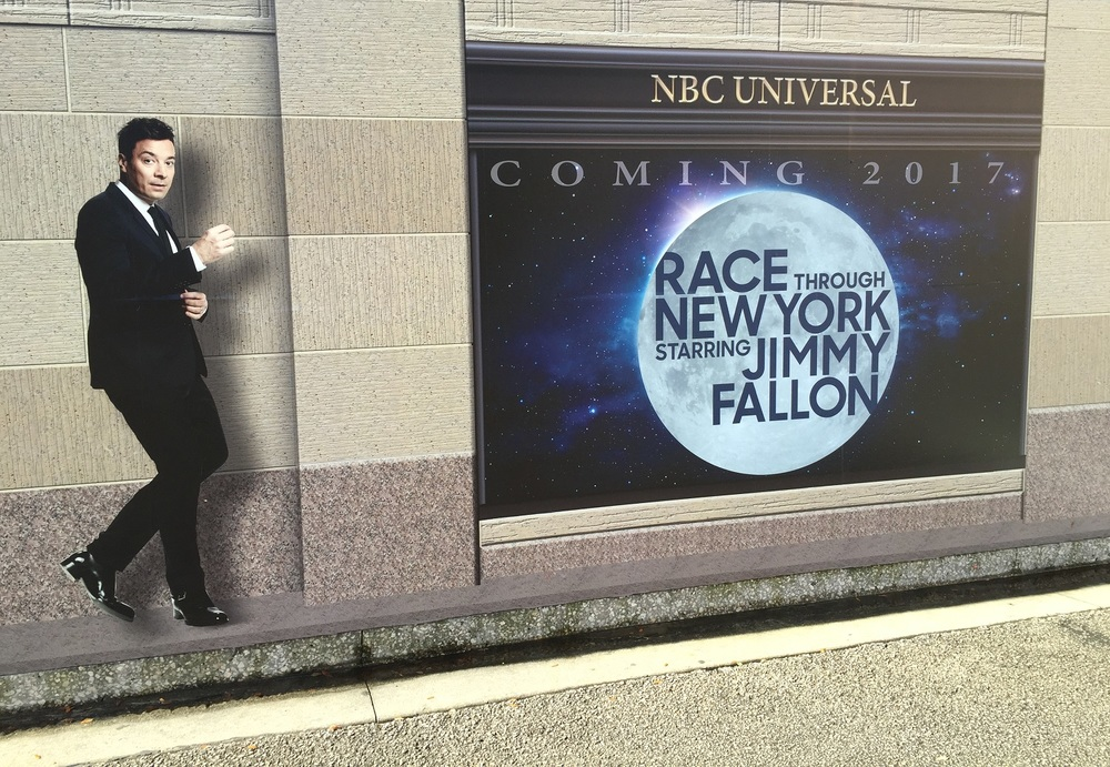 The construction wall around Race Through New York Starring Jimmy Fallon.