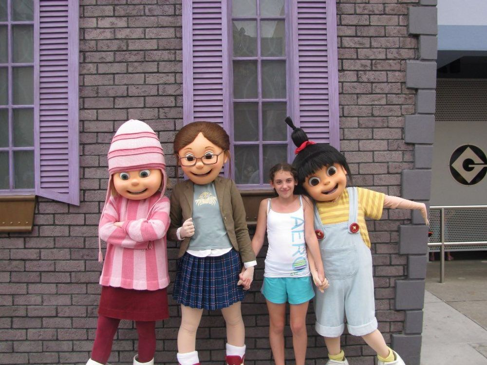 Saya with Gru's girls. Image credit:  Karla Forshey .