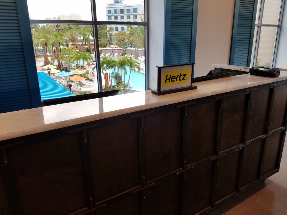 The Hertz rent-a-car desk at Loews Sapphire Falls Resort  (on the lobby level). Hotel guests can get rental car discounts at this desk.