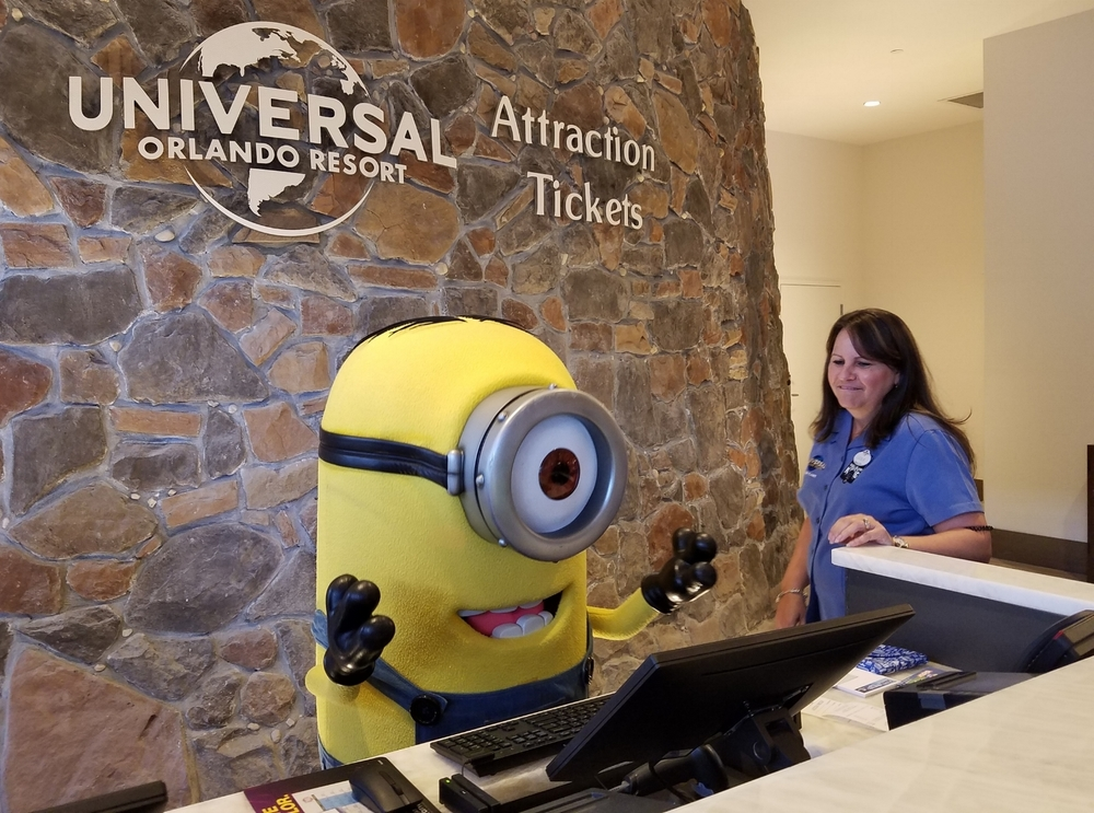 The Attractions Ticket desk at Loews Sapphire Falls Resort (on the lobby level). A Minion turned up one morning to help the Universal Team Members work the desk.