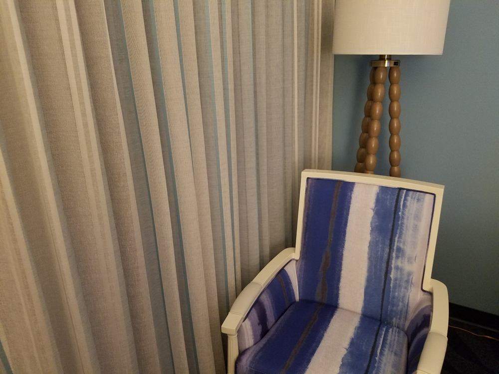 Corner chair and lamp   in a standard room at Loews Sapphire Falls Resort.