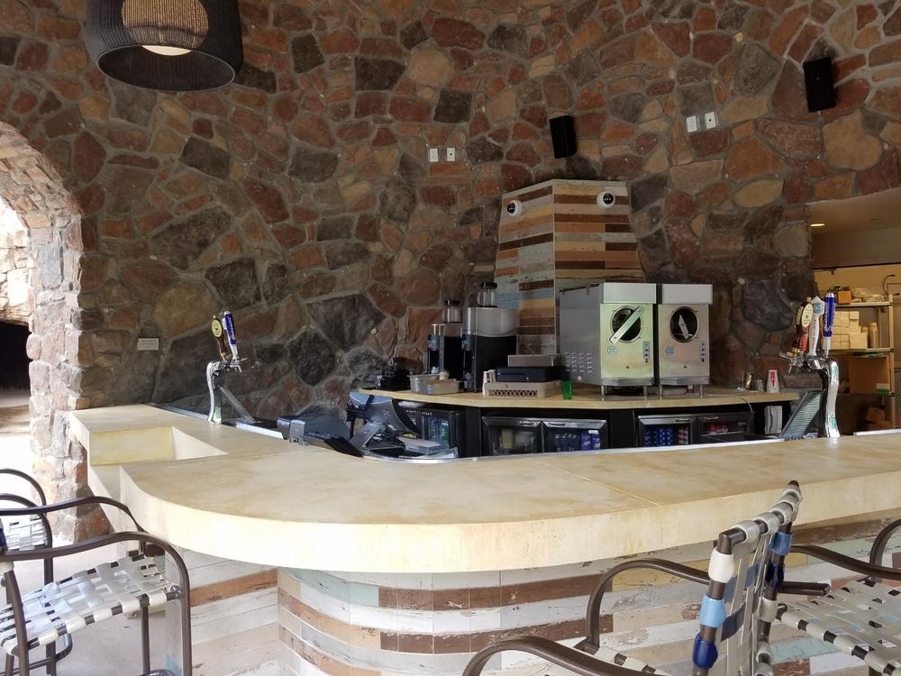 The bar inside the  Drhum Club Kantine at   Loews Sapphire Falls Resort.