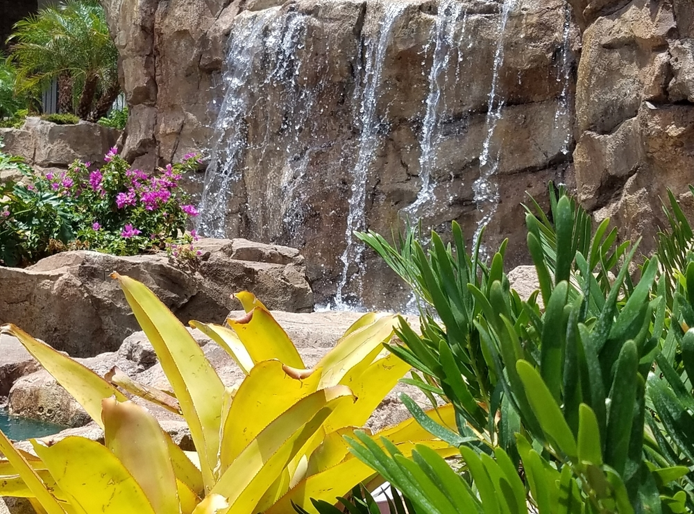 Close up of one of the waterfalls at Loews Sapphire Falls Resort.