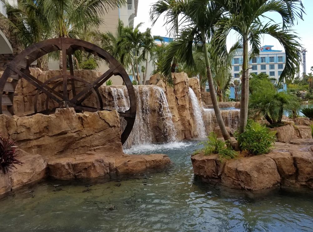 The water wheel and waterfalls at Loews Sapphire Falls Resort.