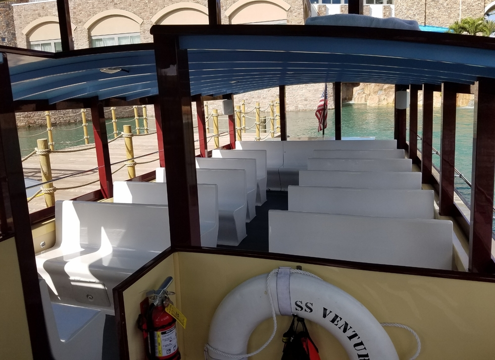 The interior of the water taxi at Loews Sapphire Falls Resort.