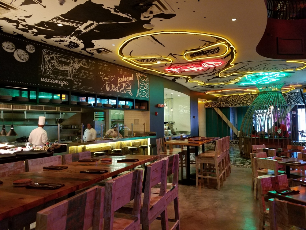 Antojitos has an open kitchen and fun art on the walls and ceilings.