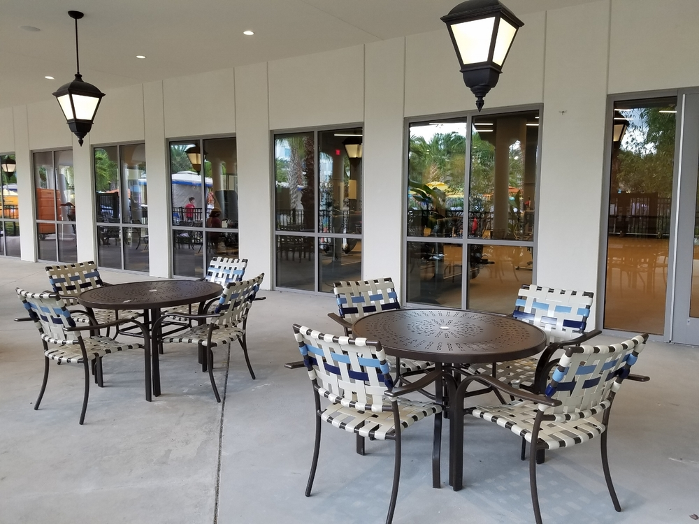 Outdoor Tables Near the Pool at Loews Sapphire Falls Resort