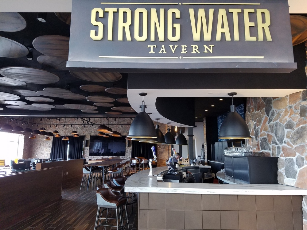 Entrance to Strong Water Tavern at Loews Sapphire Falls Resort