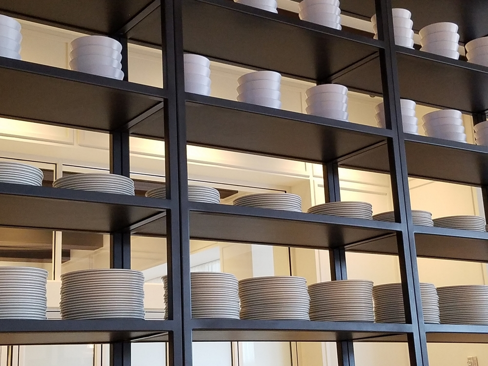 Stacks of Dishes at Amatista Cookhouse