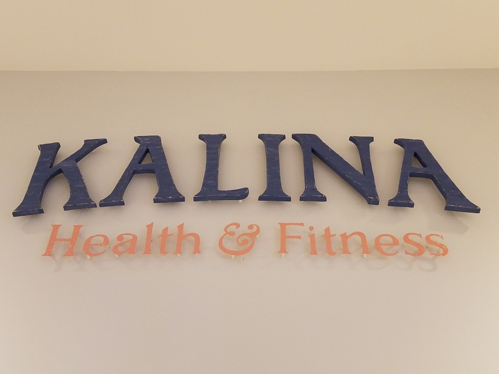 Kalina Health & Fitness Entrance Sign at Loews Sapphire Falls Resort