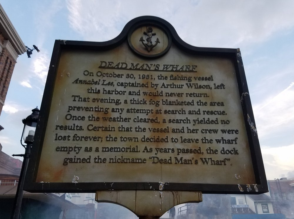 The sign at the entrance of the Dead Man's Wharf Scare Zone explains how the dock got its nickname.