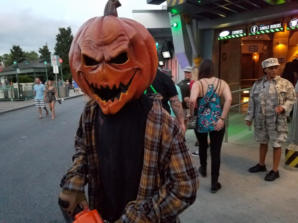The area around  TRANSFORMERS: The Ride 3-D is a good place to encounter pumpkinheads with chainsaws.