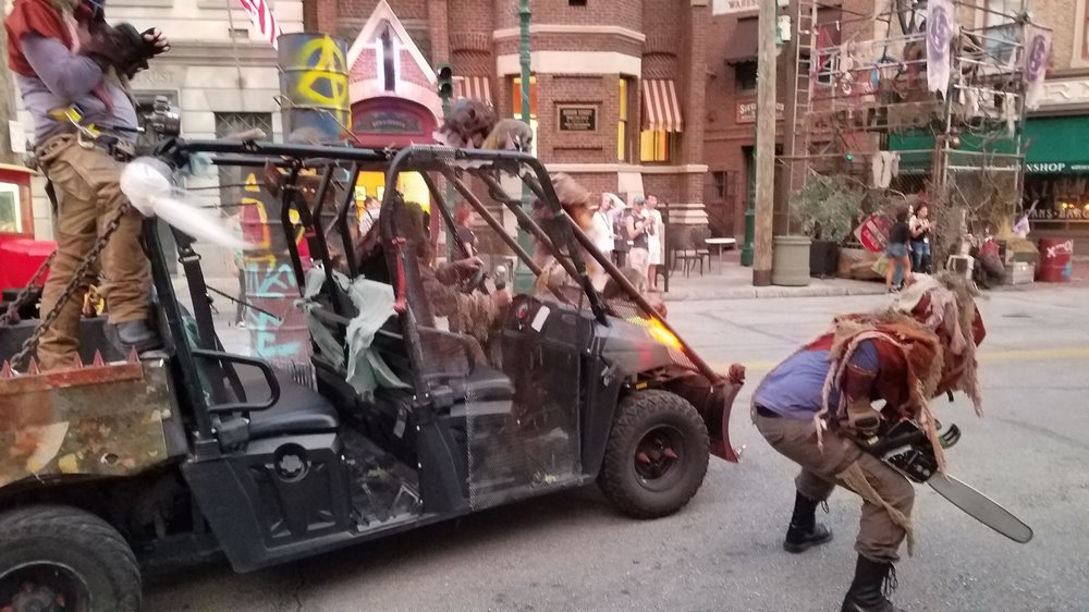 Some of the survivors travel in a vehicle through the Survive or Die Scare Zone.