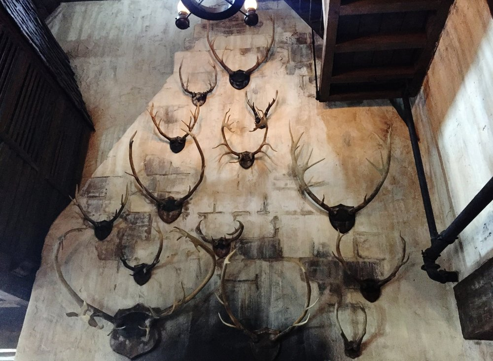 The walls at Three Broomsticks are decorated with antlers.