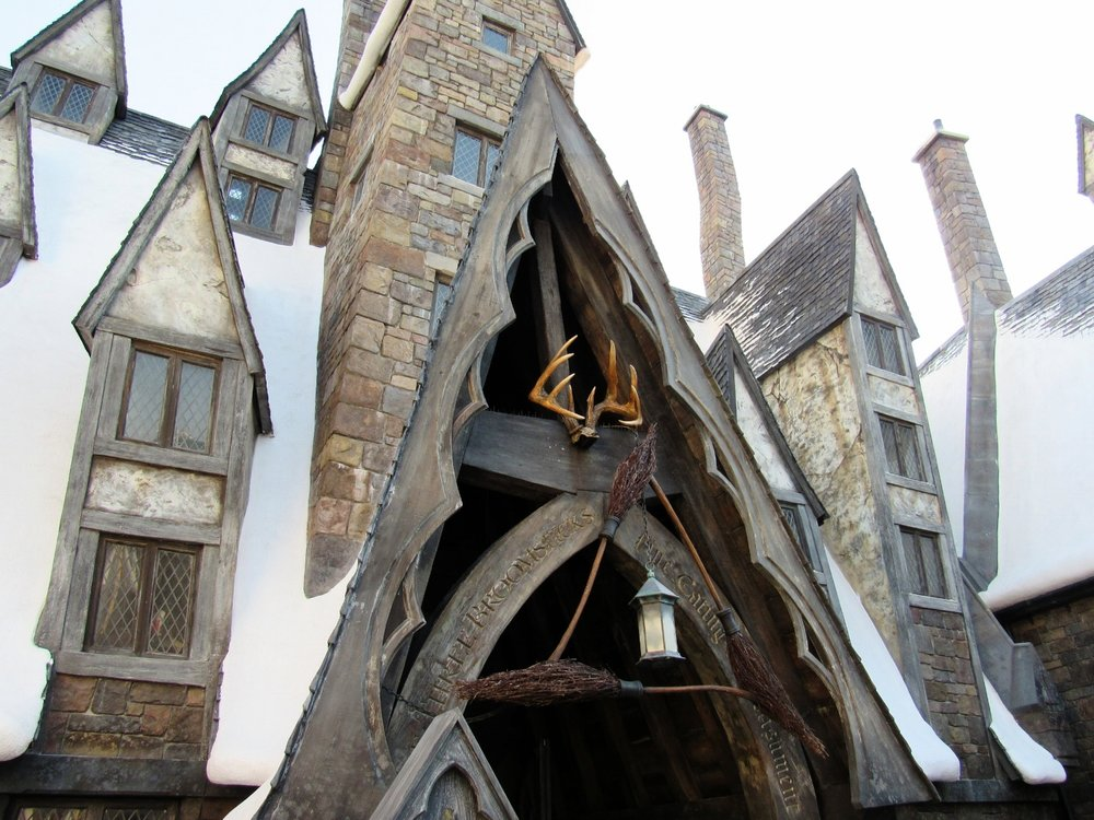Three Broomsticks Above the Entrance