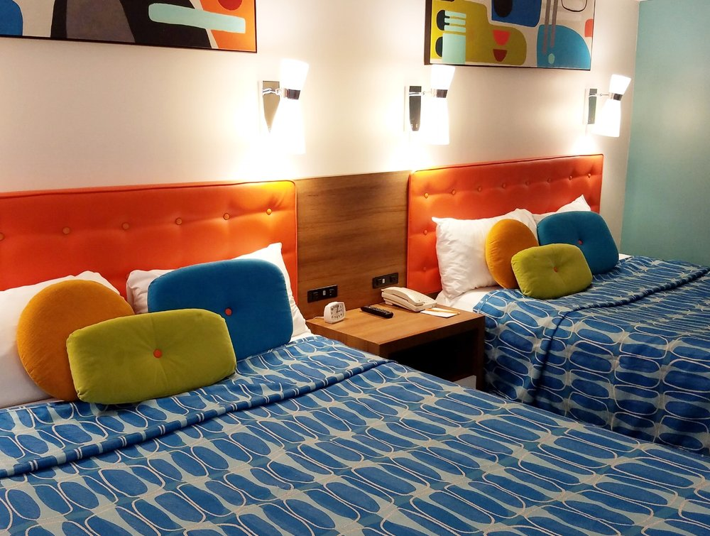 The family suite at Universal's Cabana Bay Beach Resort has two queen beds. This bedroom area is designed to sleep up to four people.