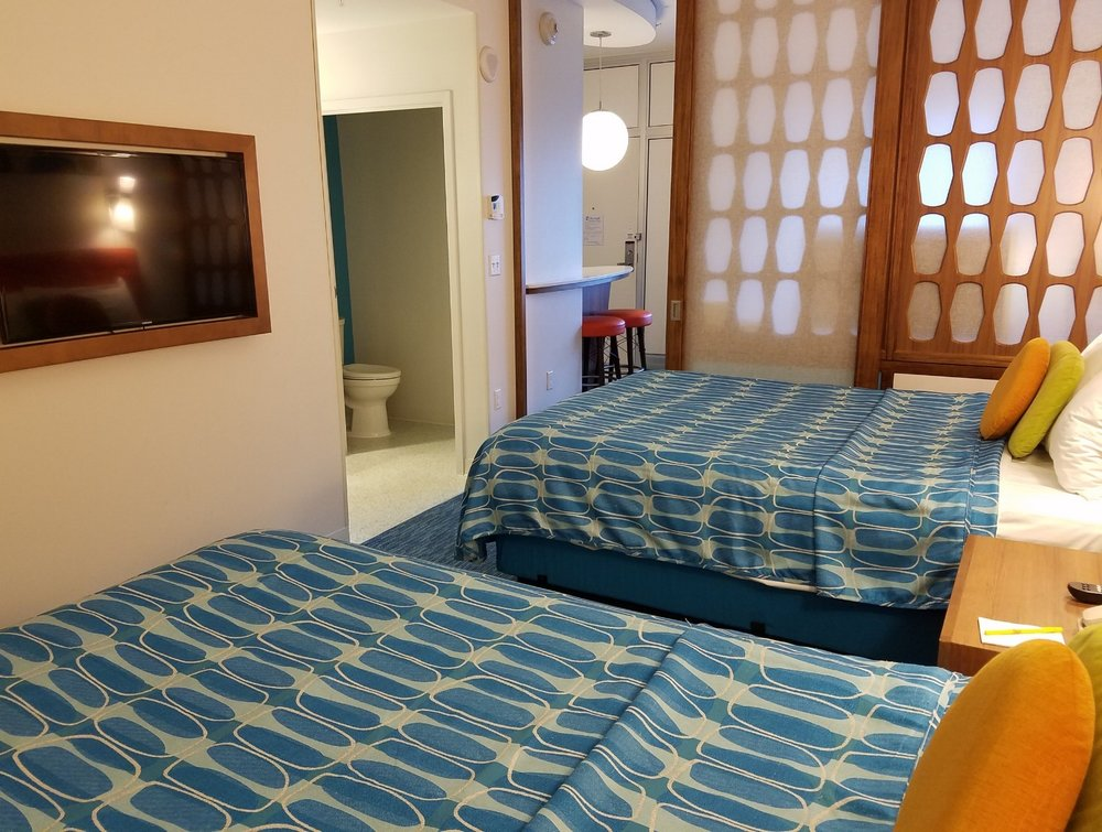 There is a TV, closet, and drawers for storage in the bedroom of the family suite at Universal's Cabana Bay Beach Resort. There is a sliding door that can be shut to separate the bedroom and living room areas.