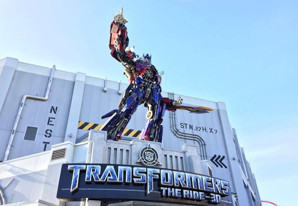The Transformers Ride is located in the Nonbiological Extraterrestrial Species Treaty (N.E.S.T.) base in Production Central. A 28-foot statue of Optimus Prime stands above the ride entrance. The ride has 13 HD screens.