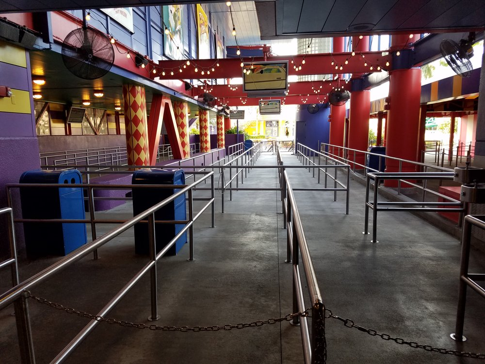 The Simpsons Ride queue is primarily a large collection of switchbacks. There isn't much to see. Most of the entertainment comes from video screens that play animated clips.