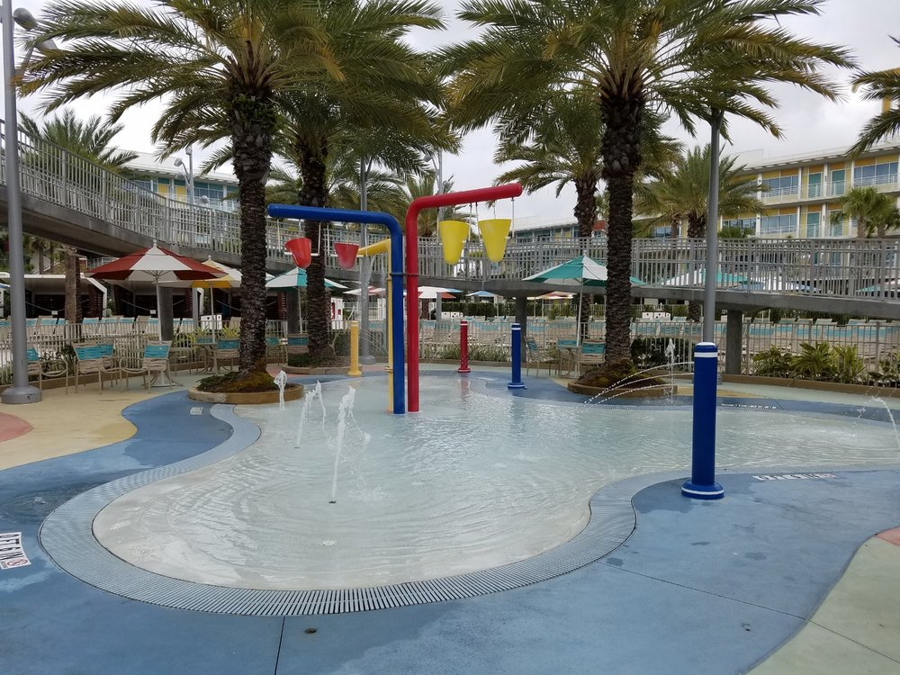 The Courtyard pool features a fenced-in kids' splash area with interactive features.