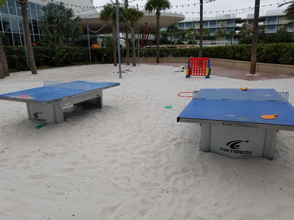 You can play table tennis and other games on a beach near the Courtyard pool.