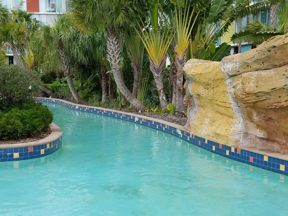 The Lazy River pool gets its name from the lazy river that winds around the pool. It takes about 5-7 minutes to float down the river (you must have a tube). You might get splashed by waterfalls or water canons.
