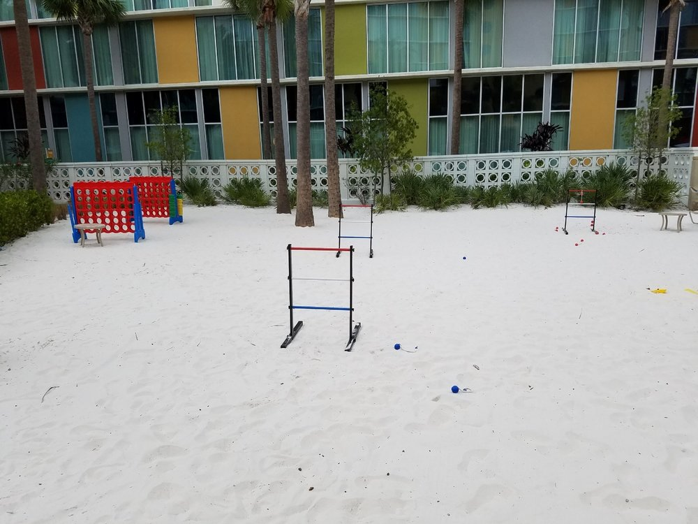 There is a small beach area near the Lazy River pool with games and other poolside activities.