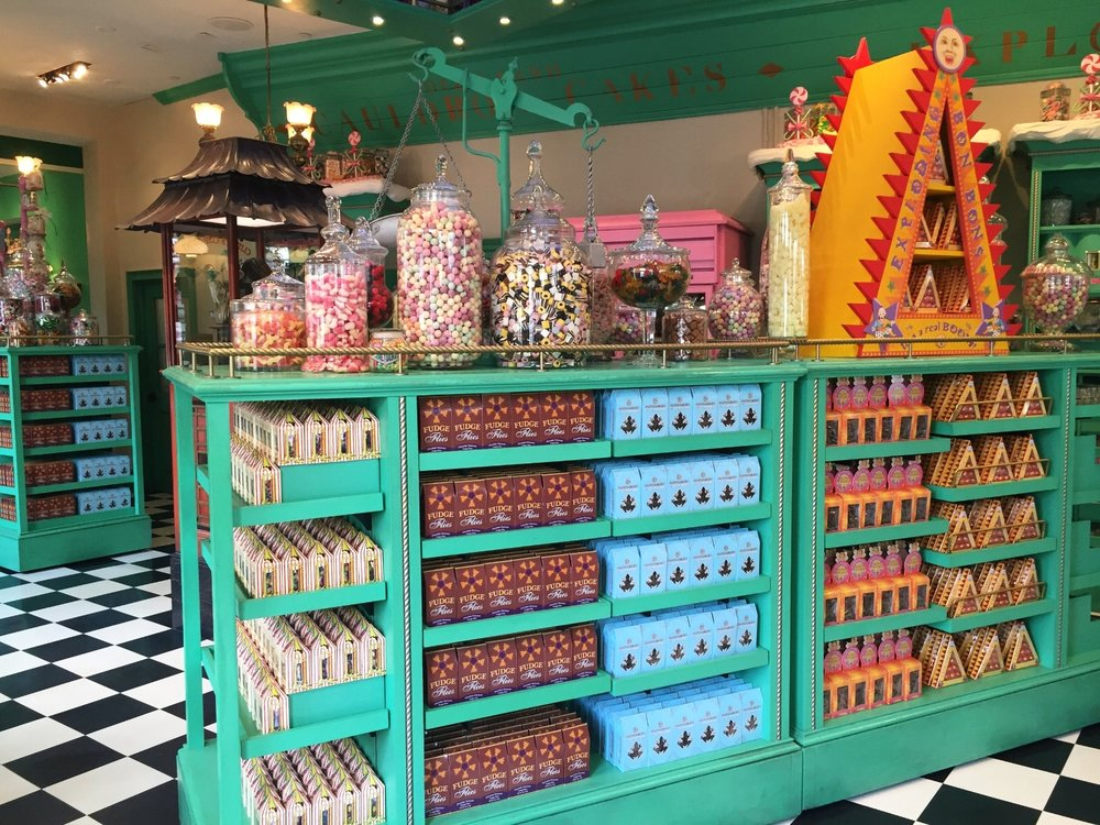 The shelves of Honeydukes are filled with candy.