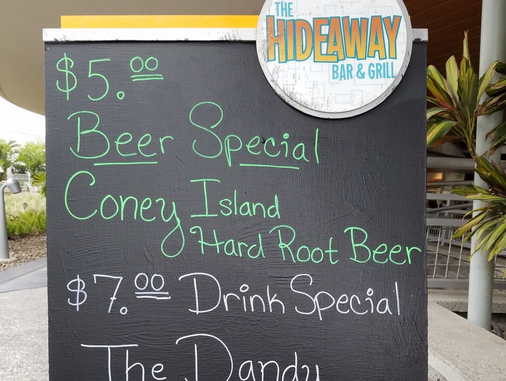 Check the chalkboard outside of Hideaway Bar and Grill for drink specials.