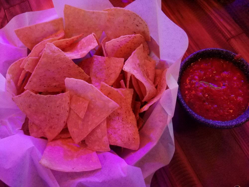 Tortilla chips and homemade salsa from Antojitos served to us for free before our meal arrived.